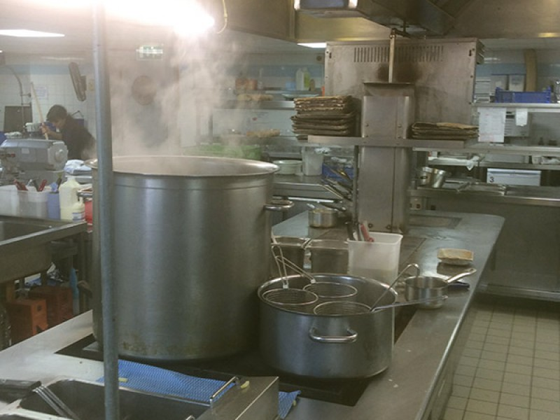 Commercial kitchen with large fans