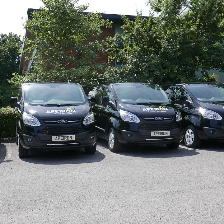 Apeiron Catering branded fleet of company vans